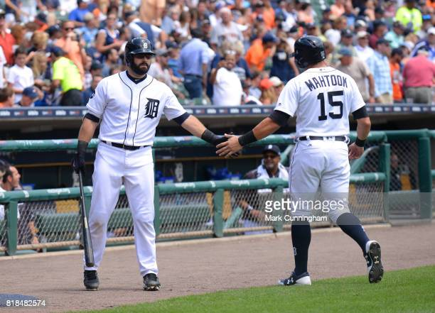 Alex Avila and Mikie Mahtook of the Detroit Tigers shake hands during the game against the Kansas City Royals at Comerica Park on June 29 2017 in...