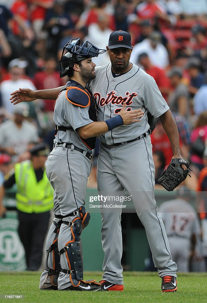<a gi-track='captionPersonalityLinkClicked' href=/galleries/search?phrase=Alex+Avila&family=editorial&specificpeople=5749211 ng-click='$event.stopPropagation()'>Alex Avila</a> #13 congratulates pitcher <a gi-track='captionPersonalityLinkClicked' href=/galleries/search?phrase=Jose+Veras&family=editorial&specificpeople=846188 ng-click='$event.stopPropagation()'>Jose Veras</a> #31of the Detroit Tigers after defeating the Boston Red Sox at Fenway Park on September 2, 2013 in Boston, Massachusetts. The Tigers won the game 3-0.