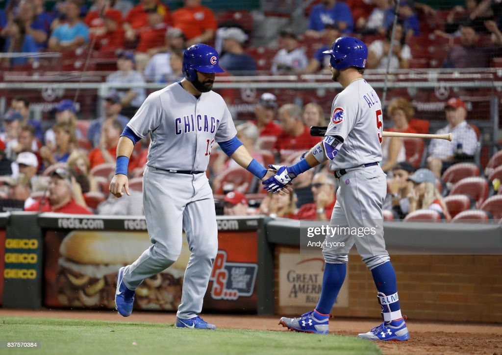 Alex Avila #13 of the Chicago Cubs is congratulated after scoring in the 8th inning by Albert Almora Jr against the Cincinnati Reds at Great American Ball Park on August 22, 2017 in Cincinnati, Ohio.