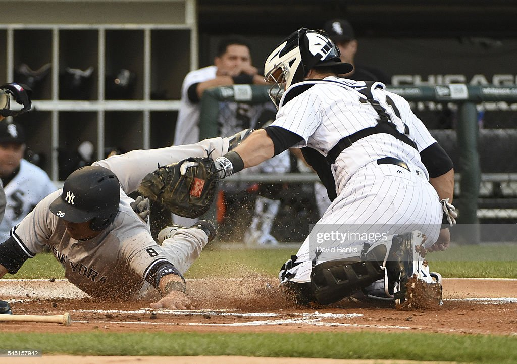 Alex Avila of the Chicago White Sox tags out Carlos Beltran of the New York Yankees at home plate during the first inning on July 5 2016 at U S...