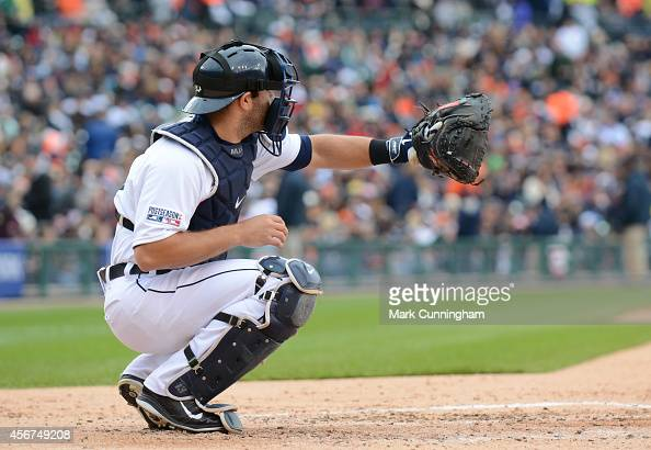 Alex Avila of the Detroit Tigers catches a baseball during Game Three of the American League Division Series against the Baltimore Orioles at...