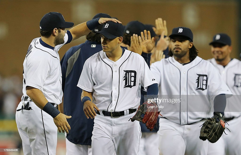 <a gi-track='captionPersonalityLinkClicked' href=/galleries/search?phrase=Alex+Avila&family=editorial&specificpeople=5749211 ng-click='$event.stopPropagation()'>Alex Avila</a> #13 of the Detroit Tigers celebrates a win over the Chicago White Sox with newly acquired infielder Jose Iglesias #1 during the game at Comerica Park on August 2, 2013 in Detroit, Michigan. The Tigers defeated the White Sox 2-1.