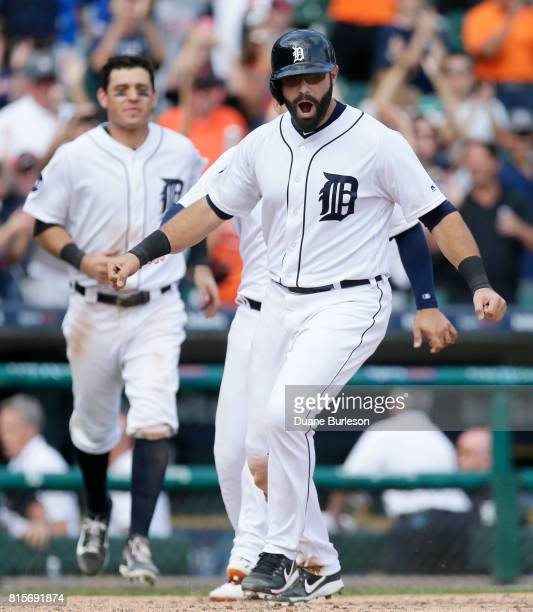 Alex Avila of the Detroit Tigers celebrates after scoring on a basesloaded walk by Miguel Cabrera of the Detroit Tigers in the 11th inning to defeat...