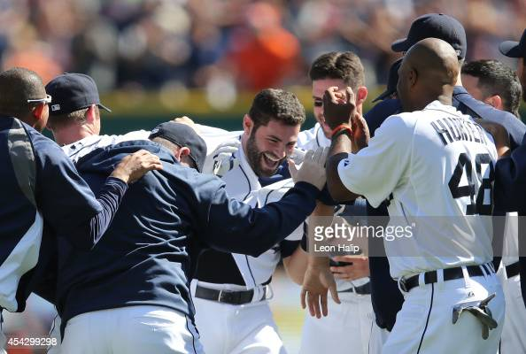 Alex Avila of the Detroit Tigers celebrates with his teammates after hitting a gamewinning walk off single to left field in the bottom of the ninth...