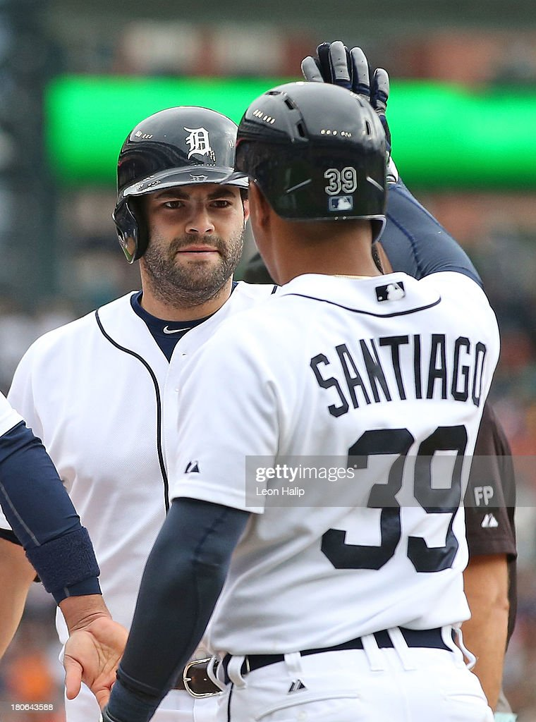 <a gi-track='captionPersonalityLinkClicked' href=/galleries/search?phrase=Alex+Avila&family=editorial&specificpeople=5749211 ng-click='$event.stopPropagation()'>Alex Avila</a> #13 of the Detroit Tigers celebrates with teammate Ramon Santiago #39 after hitting a two run home run to left field scoring <a gi-track='captionPersonalityLinkClicked' href=/galleries/search?phrase=Omar+Infante&family=editorial&specificpeople=203255 ng-click='$event.stopPropagation()'>Omar Infante</a> #4 during the second inning of the game against the Kansas City Royals at Comerica Park on September 15, 2013 in Detroit, Michigan.