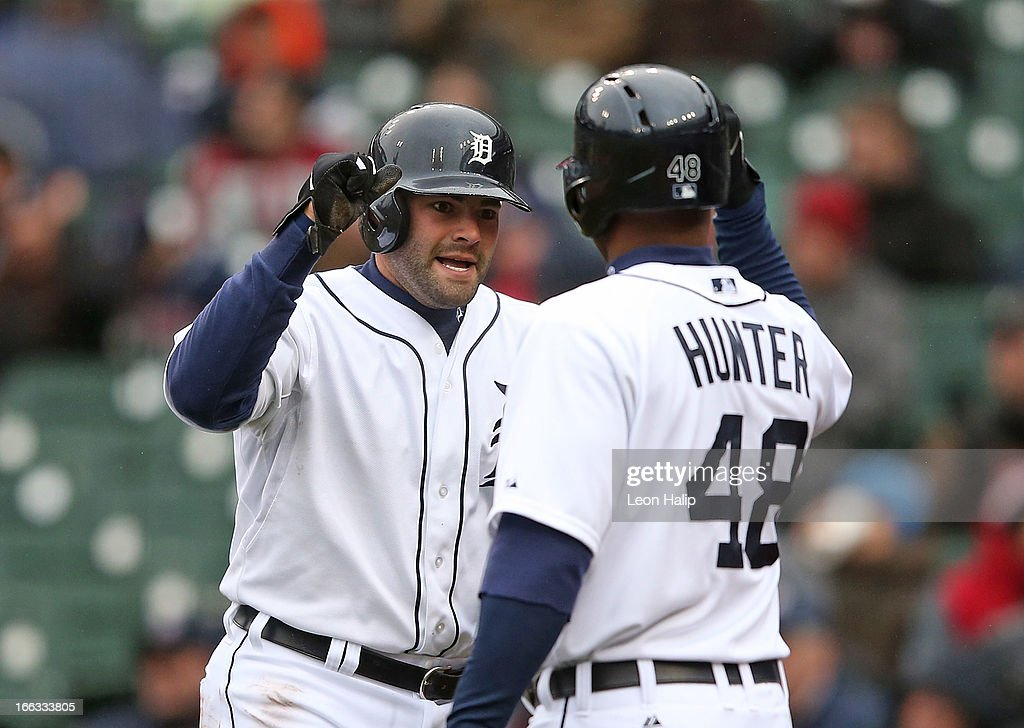 <a gi-track='captionPersonalityLinkClicked' href=/galleries/search?phrase=Alex+Avila&family=editorial&specificpeople=5749211 ng-click='$event.stopPropagation()'>Alex Avila</a> #13 of the Detroit Tigers celebrates with teammate <a gi-track='captionPersonalityLinkClicked' href=/galleries/search?phrase=Torii+Hunter&family=editorial&specificpeople=183408 ng-click='$event.stopPropagation()'>Torii Hunter</a> #48 after scoring on the single by Austin Jackson #14 duing the second inning of the game against the Toronto Blue Jays at Comerica Park on April 11, 2013 in Detroit, Michigan. The Tigers defeated the Blue Jays 11-1.