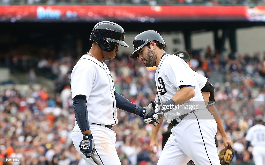 <a gi-track='captionPersonalityLinkClicked' href=/galleries/search?phrase=Alex+Avila&family=editorial&specificpeople=5749211 ng-click='$event.stopPropagation()'>Alex Avila</a> #13 of the Detroit Tigers celebrates with teammates Ramon Santiago #39 after hitting a solo run home run during the eighth inning of the game against the Kansas City Royals at Comerica Park on September 15, 2013 in Detroit, Michigan.
