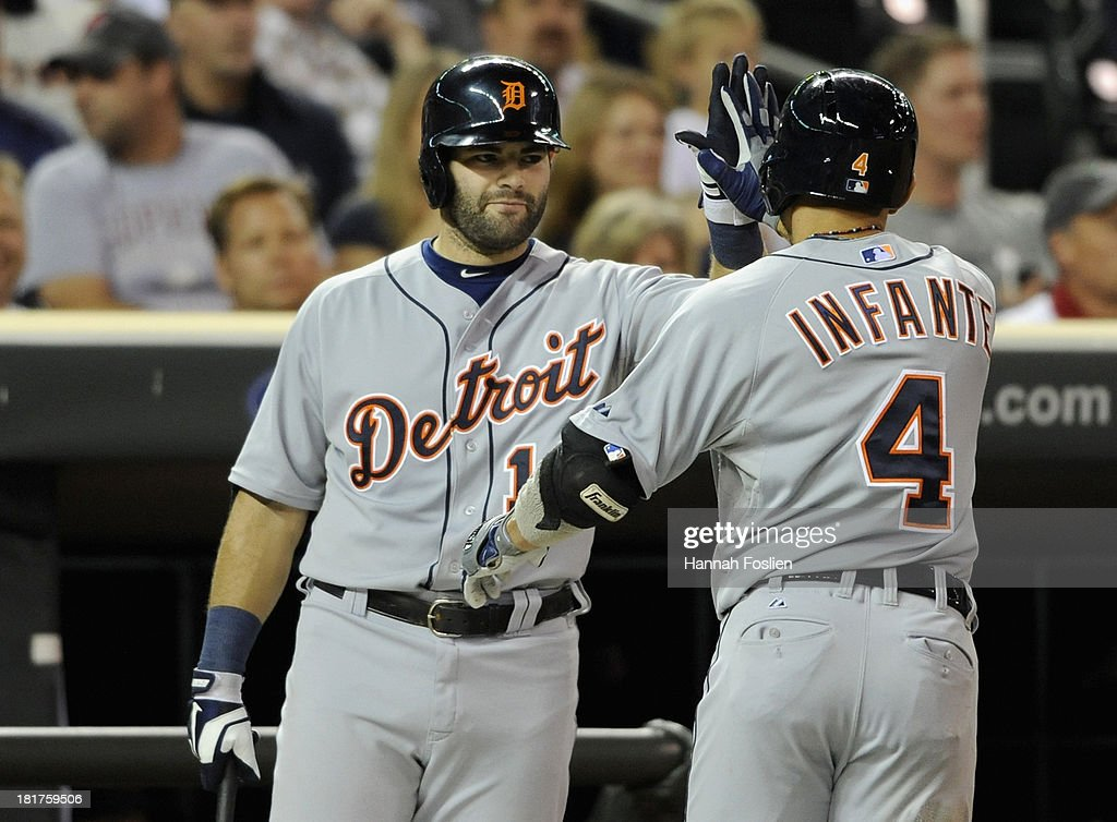 <a gi-track='captionPersonalityLinkClicked' href=/galleries/search?phrase=Alex+Avila&family=editorial&specificpeople=5749211 ng-click='$event.stopPropagation()'>Alex Avila</a> #13 of the Detroit Tigers congratulates teammate <a gi-track='captionPersonalityLinkClicked' href=/galleries/search?phrase=Omar+Infante&family=editorial&specificpeople=203255 ng-click='$event.stopPropagation()'>Omar Infante</a> #4 on a solo home run against the Minnesota Twins during the fourth inning of the game on September 24, 2013 at Target Field in Minneapolis, Minnesota.