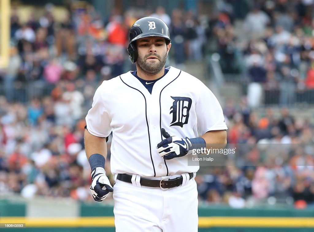 <a gi-track='captionPersonalityLinkClicked' href=/galleries/search?phrase=Alex+Avila&family=editorial&specificpeople=5749211 ng-click='$event.stopPropagation()'>Alex Avila</a> #13 of the Detroit Tigers crosses home plate after hitting a solo home run in the eighth inning during the game against the Kansas City Royals at Comerica Park on September 15, 2013 in Detroit, Michigan.