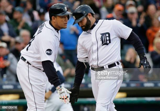 Alex Avila of the Detroit Tigers is congratulated by Miguel Cabrera of the Detroit Tigers after hitting a solo home run against the Texas Rangers...
