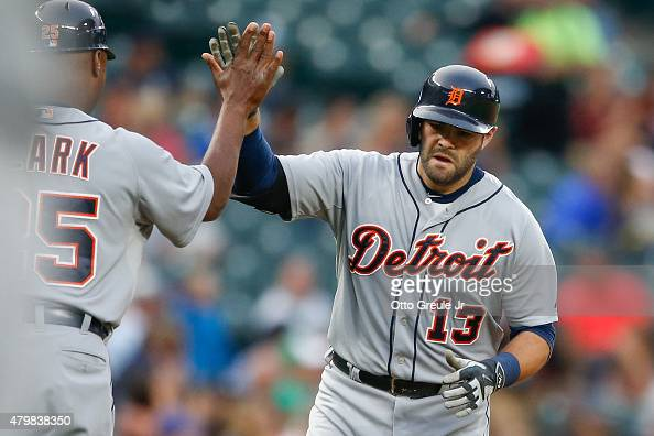 Alex Avila of the Detroit Tigers is congratulated by third base coach Dave Clark after hitting a tworun home run against the Seattle Mariners in the...