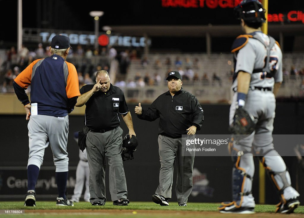 Alex Avila #13 of the Detroit Tigers looks on as his manager Jim Leyland #10 speaks with umpires Brian O'Nora #7 and Fieldin Culbreth #25 during the second inning of the game against the Minnesota Twins on September 24, 2013 at Target Field in Minneapolis, Minnesota.