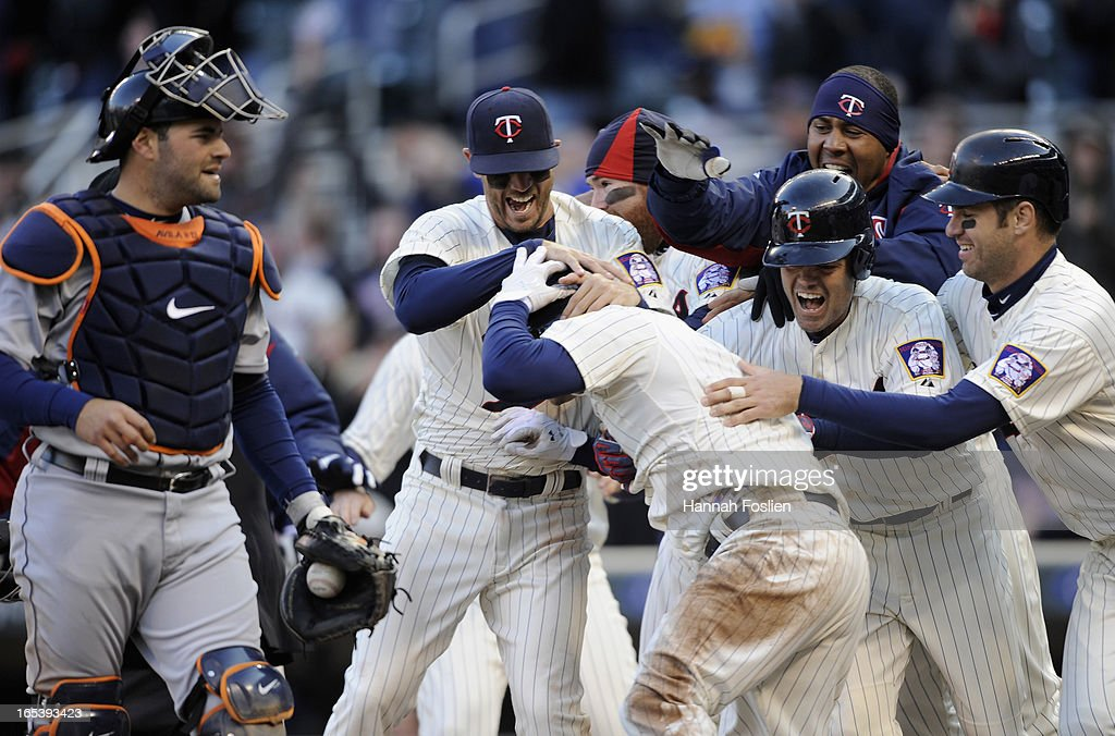 Alex Avila of the Detroit Tigers looks on as the Minnesota Twins celebrate a walk off double during the ninth inning of the game on April 3 2013 at...