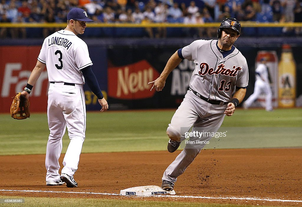 <a gi-track='captionPersonalityLinkClicked' href=/galleries/search?phrase=Alex+Avila&family=editorial&specificpeople=5749211 ng-click='$event.stopPropagation()'>Alex Avila</a> #13 of the Detroit Tigers rounds third base in front of third baseman <a gi-track='captionPersonalityLinkClicked' href=/galleries/search?phrase=Evan+Longoria&family=editorial&specificpeople=2349329 ng-click='$event.stopPropagation()'>Evan Longoria</a> #3 of the Tampa Bay Rays on his way to score on a one-run single by Rajai Davis during the sixth inning of a game against the Tampa Bay Rays on August 19, 2014 at Tropicana Field in St. Petersburg, Florida.