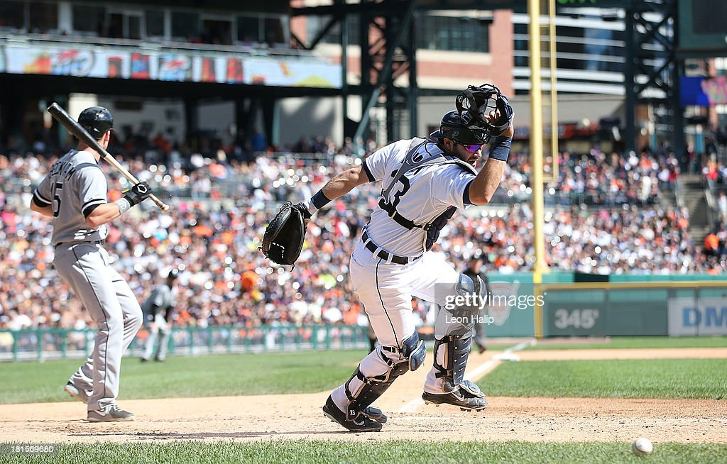 <a gi-track='captionPersonalityLinkClicked' href=/galleries/search?phrase=Alex+Avila&family=editorial&specificpeople=5749211 ng-click='$event.stopPropagation()'>Alex Avila</a> #13 of the Detroit Tigers scrambles for the loose ball during the fifth inning of the game against the Chicago White Sox at Comerica Park on September 22, 2013 in Detroit, Michigan.