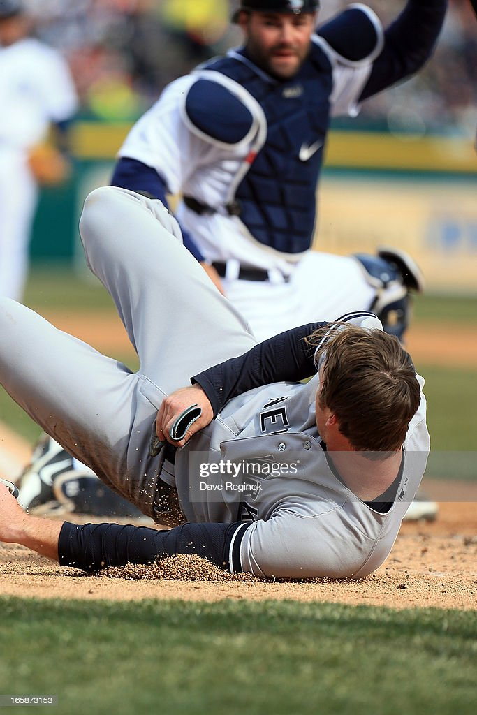 <a gi-track='captionPersonalityLinkClicked' href=/galleries/search?phrase=Alex+Avila&family=editorial&specificpeople=5749211 ng-click='$event.stopPropagation()'>Alex Avila</a> #13 of the Detroit Tigers tags out at home plate <a gi-track='captionPersonalityLinkClicked' href=/galleries/search?phrase=Brennan+Boesch&family=editorial&specificpeople=6754960 ng-click='$event.stopPropagation()'>Brennan Boesch</a> #22 of the New York Yankees at Comerica Park on April 6, 2013 in Detroit, Michigan. The Tigers won 8-4