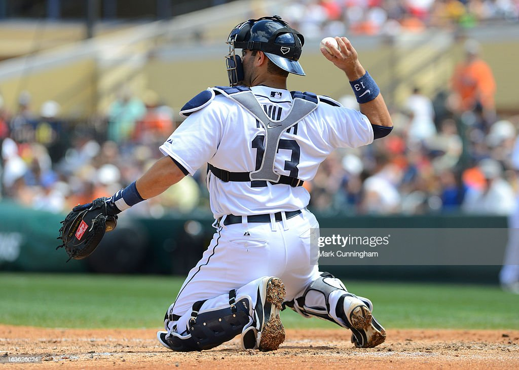 Alex Avila #13 of the Detroit Tigers throws a baseball during the spring training game against the Washington Nationals at Joker Marchant Stadium on March 10, 2013 in Lakeland, Florida. The Tigers defeated the Nationals 2-1.