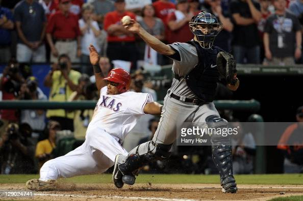 Alex Avila of the Detroit Tigers throws to first base after making the force out at home plate on Adrian Beltre of the Texas Rangers to end the ninth...