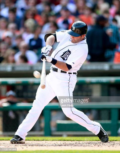 Alex Avila of the Detroit Tigers triples to deep center field scoring Ryan Raburn and Jhonny Peralta in the fourth inning of the game against the...