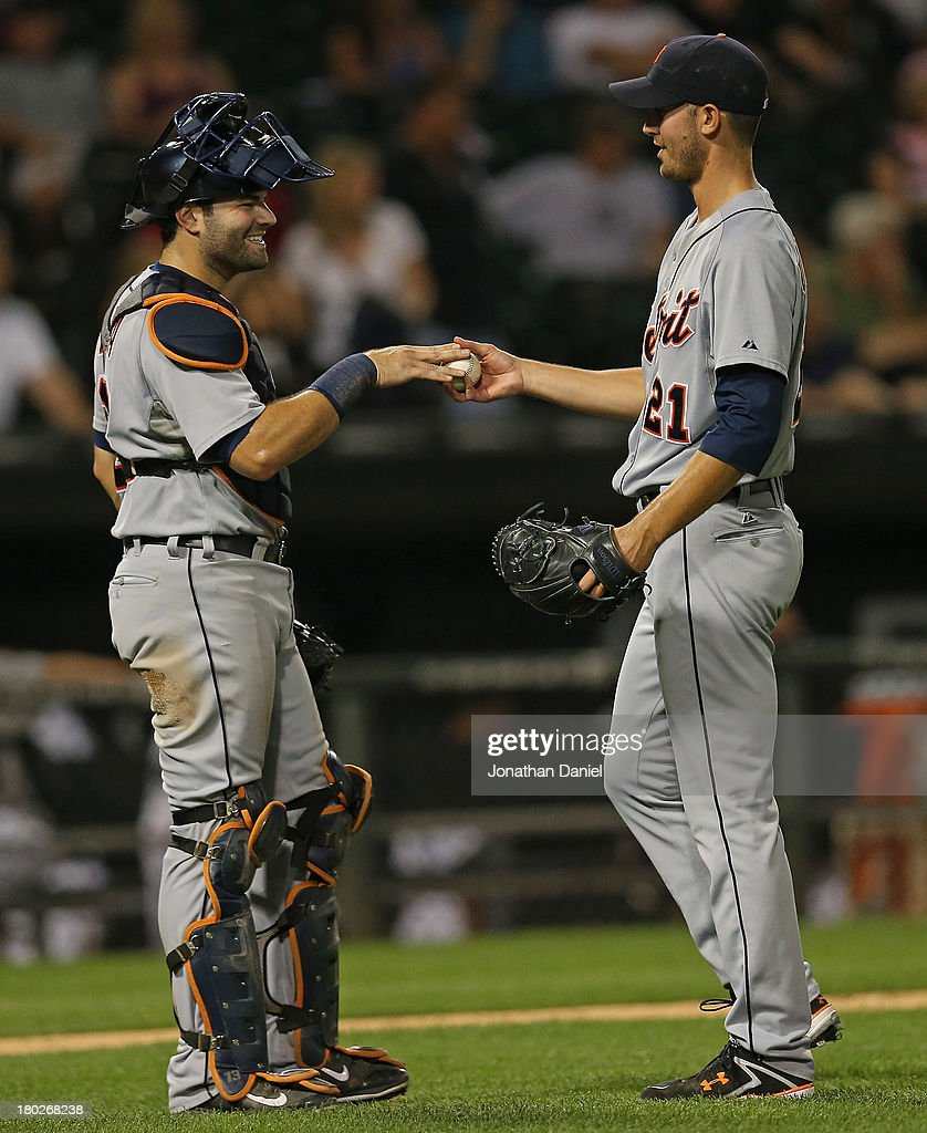<a gi-track='captionPersonalityLinkClicked' href=/galleries/search?phrase=Alex+Avila&family=editorial&specificpeople=5749211 ng-click='$event.stopPropagation()'>Alex Avila</a> #13 of the the Detroit Tigers (L) hands the ball to <a gi-track='captionPersonalityLinkClicked' href=/galleries/search?phrase=Rick+Porcello&family=editorial&specificpeople=4495644 ng-click='$event.stopPropagation()'>Rick Porcello</a> #21 after Porcello's complete game win over the Chicago White Sox at U.S. Cellular Field on September 10, 2013 in Chicago, Illinois. The Tigers defeated the White Sox 9-1.