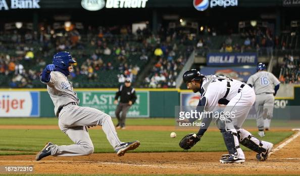 Alex Avilia of the Detroit Tigers gets ready to tag out Chris Getz of the Kansas City Royals at the plate during the fourth inning of the game at...