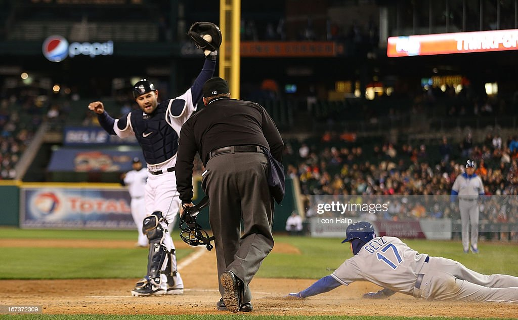 Alex Avilia #13 of the Detroit Tigers shows the ball to home plate umpire Fieldin Culbreth after tagging out <a gi-track='captionPersonalityLinkClicked' href=/galleries/search?phrase=Chris+Getz&family=editorial&specificpeople=4936717 ng-click='$event.stopPropagation()'>Chris Getz</a> #17 of the Kansas City Royals at the plate during the fourth inning of the game at Comerica Park on April 24, 2013 in Detroit, Michigan.