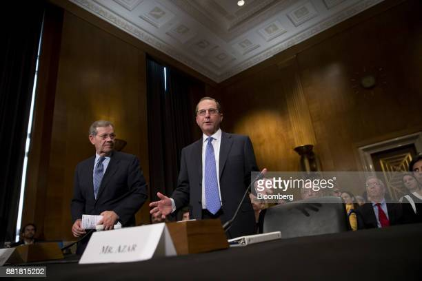 Alex Azar secretary of Health and Human Services nominee for US President Donald Trump right arrives for a Senate Health Education Labor and Pension...