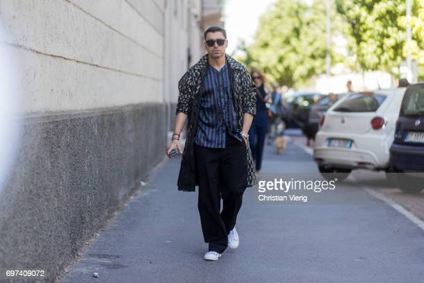 Alex Badia is seen outside MSGM during Milan Men's Fashion Week Spring/Summer 2018 on June 18 2017 in Milan Italy