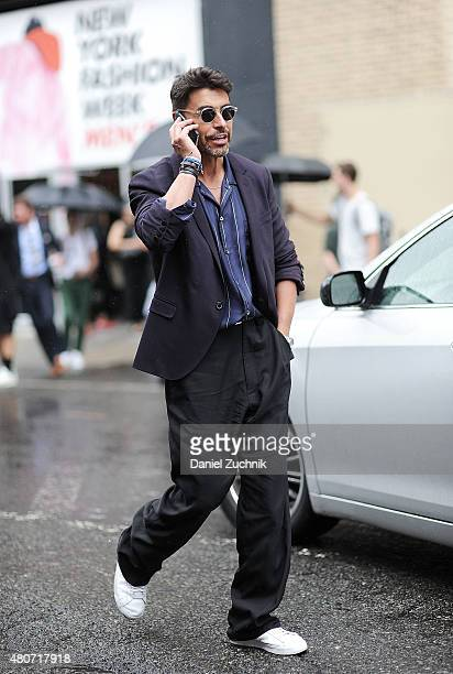 Alex Badia is seen outside the Duckie Brown show wearing a Lanvin blazer Marc Jacobs shirt Lanvin pants Nike sneakers and Moscot sunglasses during...