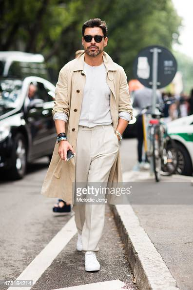 Alex Badia of WWD wears a Ferragamo jacket Marc Jacobs shirt Zegna pants Nike shoes and Ahlen sunglasses on June 23 2015 in Milan Italy