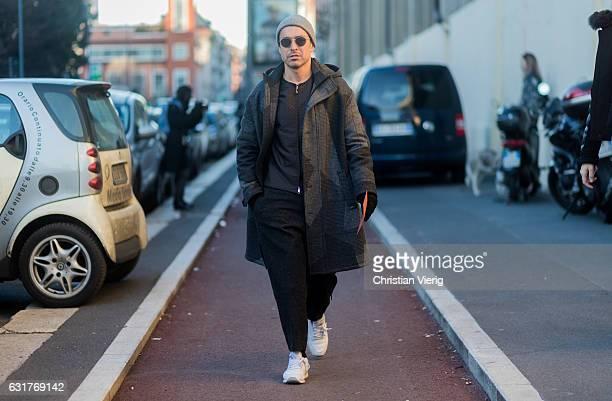 Alex Badia wearing a beanie sunglasses black pants grey coat during Milan Men's Fashion Week Fall/Winter 2017/18 at Missoni on January 15 2017 in...