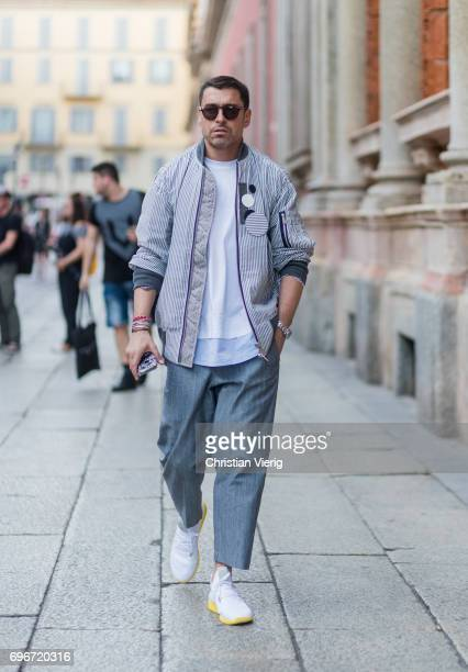 Alex Badia wearing a grey pants and bomber jacket is seen outside Ermenegildo Zegna during Milan Men's Fashion Week Spring/Summer 2018 on June 16...