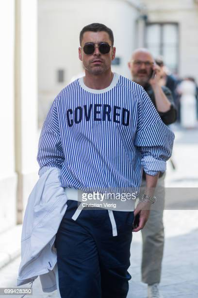 Alex Badia wearing a knit with the print Covered outside Lemaire during Paris Fashion Week Menswear Spring/Summer 2018 on June 21 2017 in Paris France