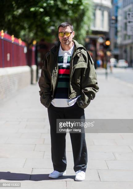 Alex Badia wearing a military jacket and jogger pants during the London Fashion Week Men's June 2017 collections on June 10 2017 in London England