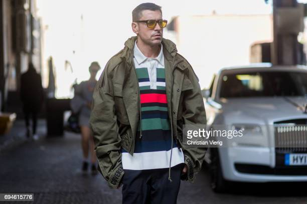 Alex Badia wearing a military jacket during the London Fashion Week Men's June 2017 collections on June 10 2017 in London England