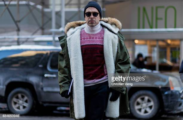 Alex Badia wearing a parka knit beanie outside Calvin Klein on February 10 2017 in New York City