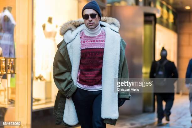 Alex Badia wearing a parka knit beanie sunglasses outside Jason Wu on February 10 2017 in New York City