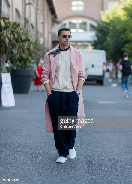 Alex Badia wearing a pink coat scarf jogger pants sneakers is seen outside Malibu 1992 during Milan Men's Fashion Week Spring/Summer 2018 on June 19...