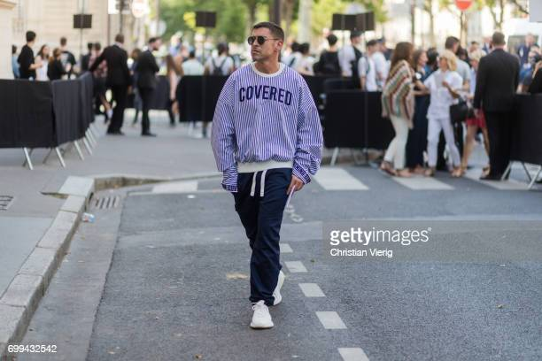 Alex Badia wearing a striped knit with the print Covered outside Valentino during Paris Fashion Week Menswear Spring/Summer 2018 on June 21 2017 in...