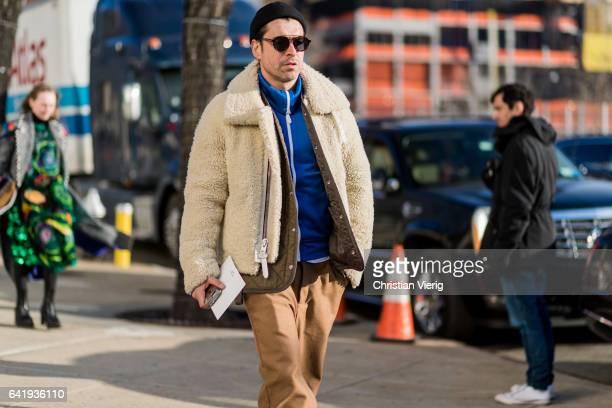 Alex Badia wearing a teddy coat beanie outside Coach on February 14 2017 in New York City