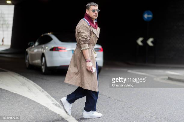 Alex Badia wearing a trench coat during the London Fashion Week Men's June 2017 collections on June 9 2017 in London England