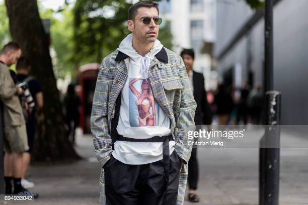 Alex Badia wearing a white hoody with a print of a woman in underwear during the London Fashion Week Men's June 2017 collections on June 11 2017 in...
