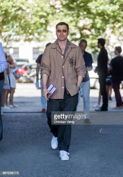Alex Badia wearing black pants brown button shirt is seen outside Neil Barrett during Milan Men's Fashion Week Spring/Summer 2018 on June 17 2017 in...