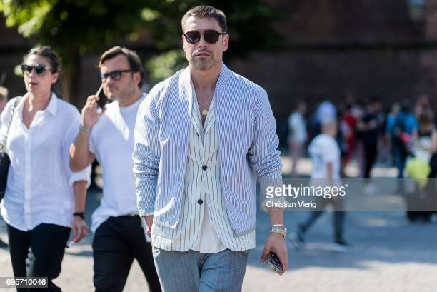 Alex Badia wearing grey pants jacket striped blazer is seen during Pitti Immagine Uomo 92 at Fortezza Da Basso on June 13 2017 in Florence Italy