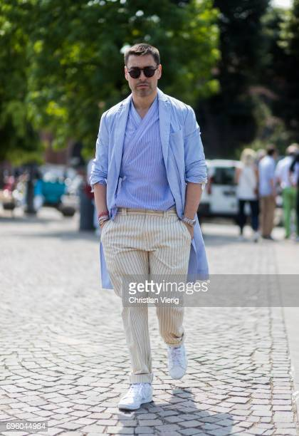 Alex Badia wearing striped beige pants blue jacket is seen during Pitti Immagine Uomo 92 at Fortezza Da Basso on June 14 2017 in Florence Italy