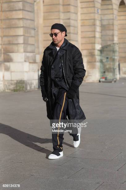 Alex Badia wears 31 Phillip Lim and Dior Homme outside the Balenciaga show at Place Vendome on January 18 2017 in Paris France
