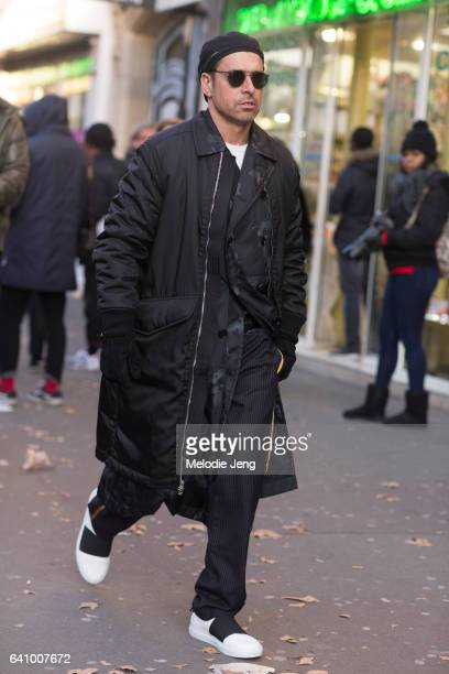 Alex Badia wears 31 Phillip Lim and Dior Homme outside the Y/PROJECT show on January 18 2017 in Paris France