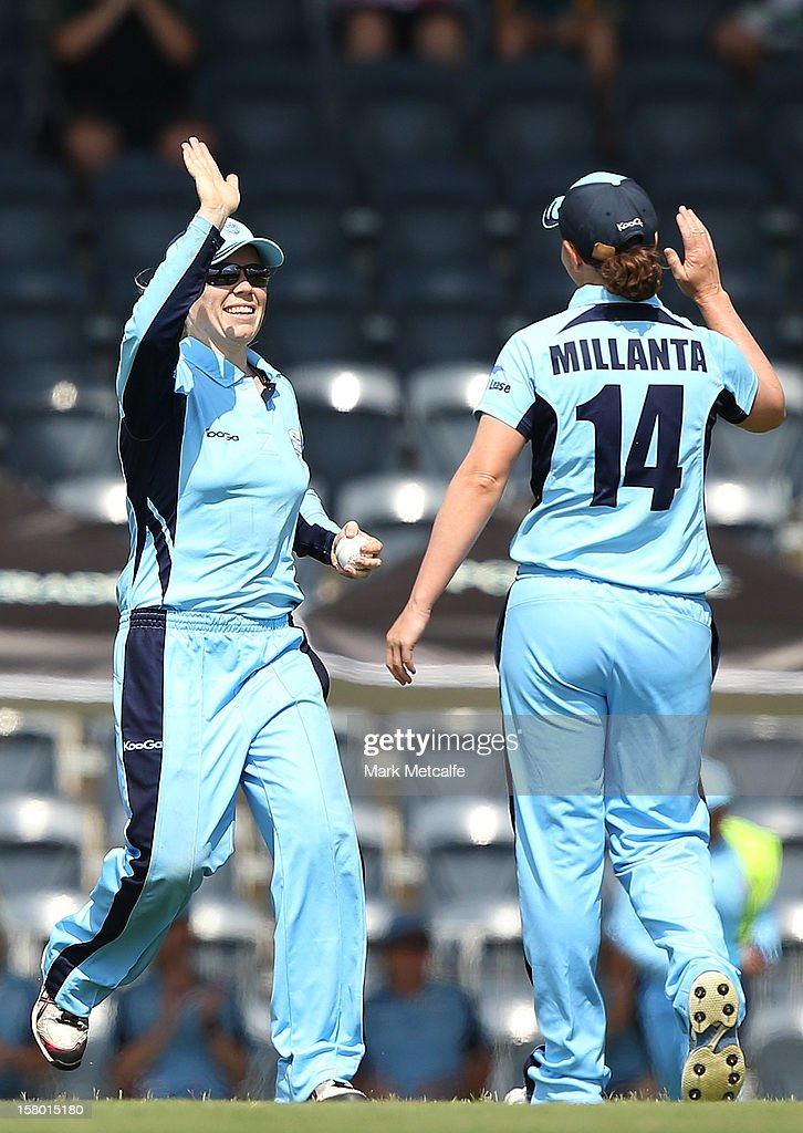 Alex Balckwell and Sharon Millanta of the Breakers celebrate taking the wicket of Carly Ryan of the Roar during the women's Twenty20 match between the New South Wales Breakers and the Tasmania Roar at Blacktown International Sportspark on December 9, 2012 in Sydney, Australia.