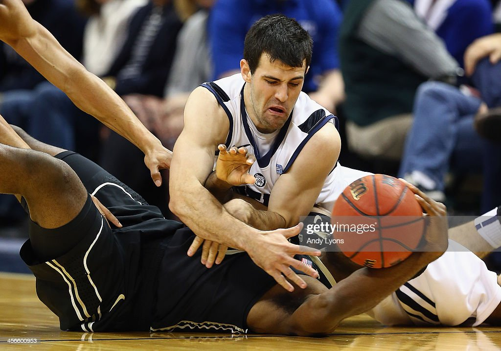 Alex Barlow #3 of the Butler Bulldogs and Rapheal Davis #35 of the Purdue Boilermakers battle for a loose ball during the 2013 Crossroads Classic at Bankers Life Fieldhouse on December 14, 2013 in Indianapolis, Indiana.