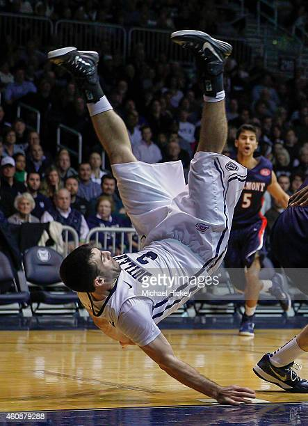 Alex Barlow of the Butler Bulldogs falls off of a Belmont Bruins player's back at Hinkle Fieldhouse on December 28 2014 in Indianapolis Indiana...